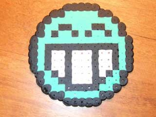 "A laughing emoticon, made with ""Perler Beads""."