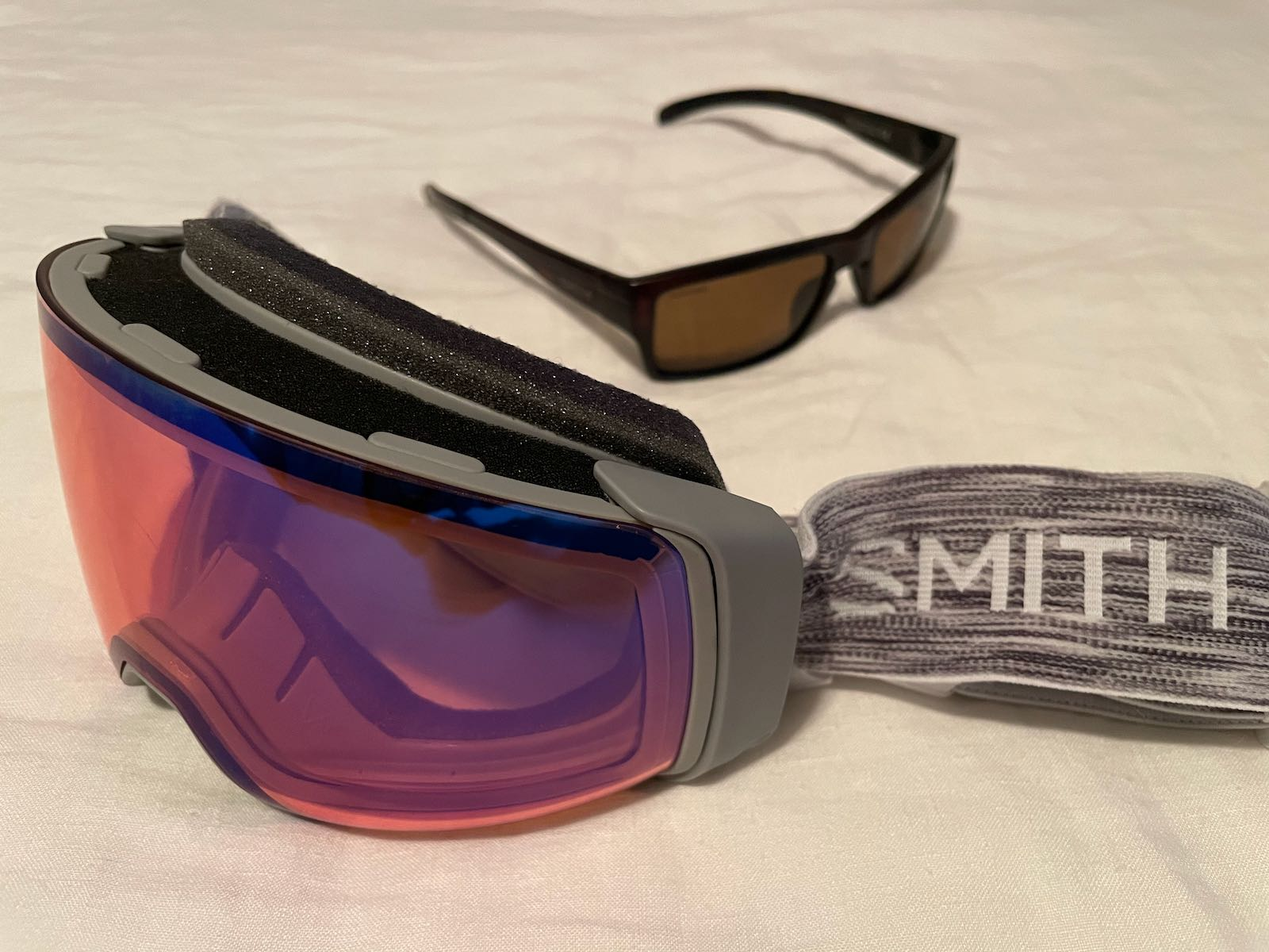 "The Smith ski goggles, beside my ""all-weather"" Smith sunglasses."