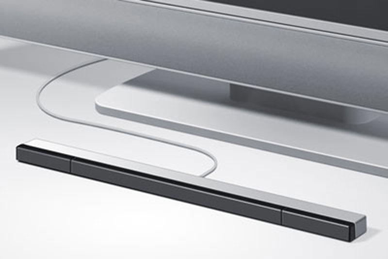 "Photo of a Nintendo Wii ""sensor bar,"" positioned in front of a TV."