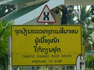 A traffic changeover sign in Thailand.